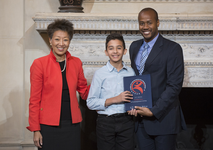 SAY's Confident Voices Program Wins Nation's Top Honor! Pictured: NEA Chairman Jane Chu, SAY Participant Reuben, and SAY Director of Programming Travis Robertson